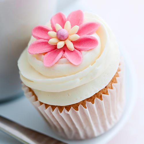 bigstock-Cupcake-decorated-with-a-pink--59540714