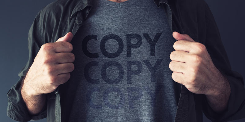 Man in a T-shirt with word COPY written on it three times