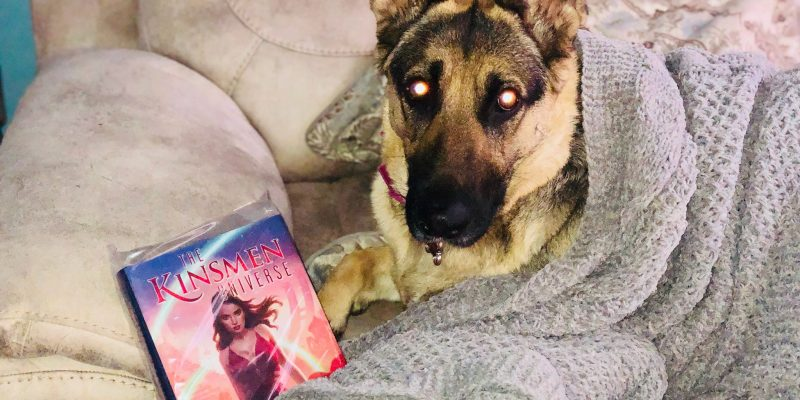 Artha snuggling with her copy
