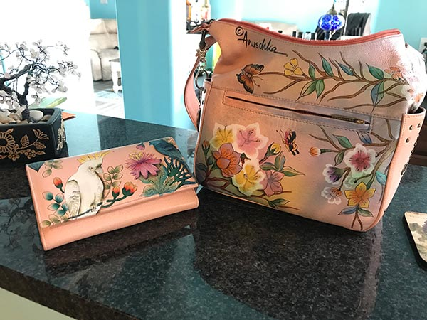 Pink purse with flowers on it.